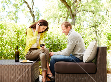 stock-photo-26640968-couple-holding-wine-glasses-at-resort