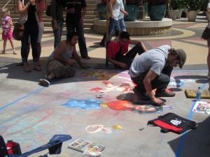 Guy using sidewalk chalk