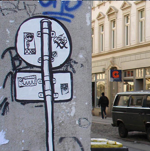 signpost-sticker-street-art