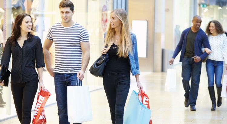 Shoppers walking inside a mall