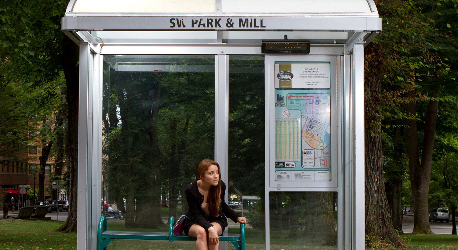 Passenger waiting in a bus stop