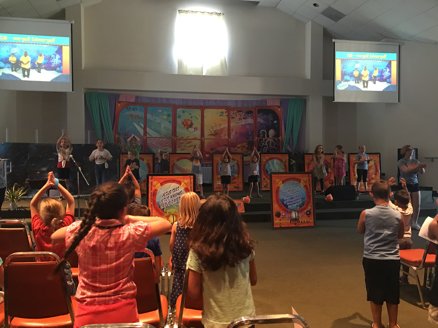 Kids in a worship activity hosted by the Sonrise Church