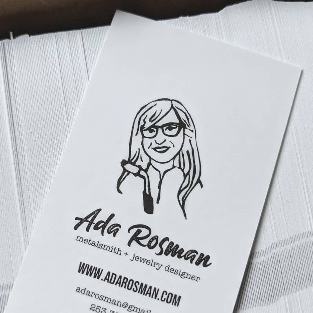 simple white business card with girl drawing